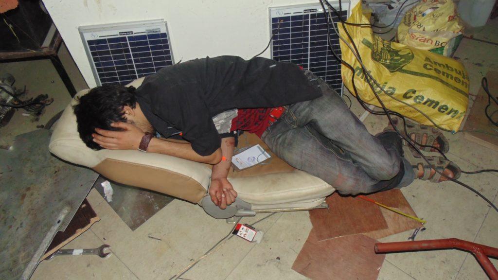 Solar Go-kart Team Member Sleeping In lab