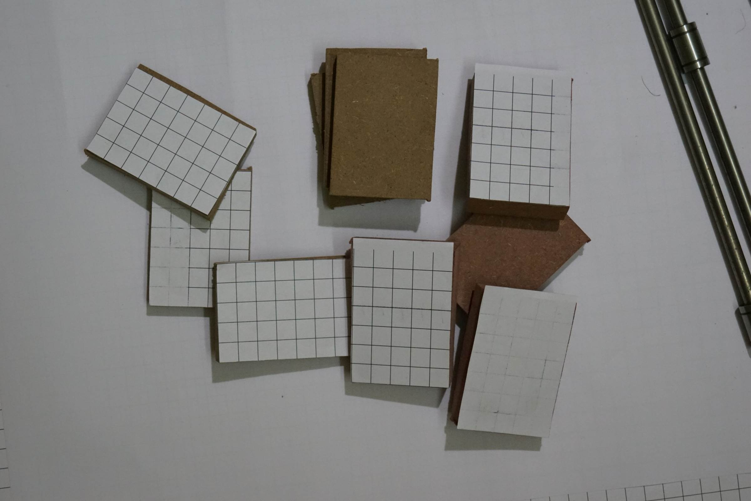 Small pieces of MDF Board covered with Grid Paper for Axes Joints and Linear Bearing Holder