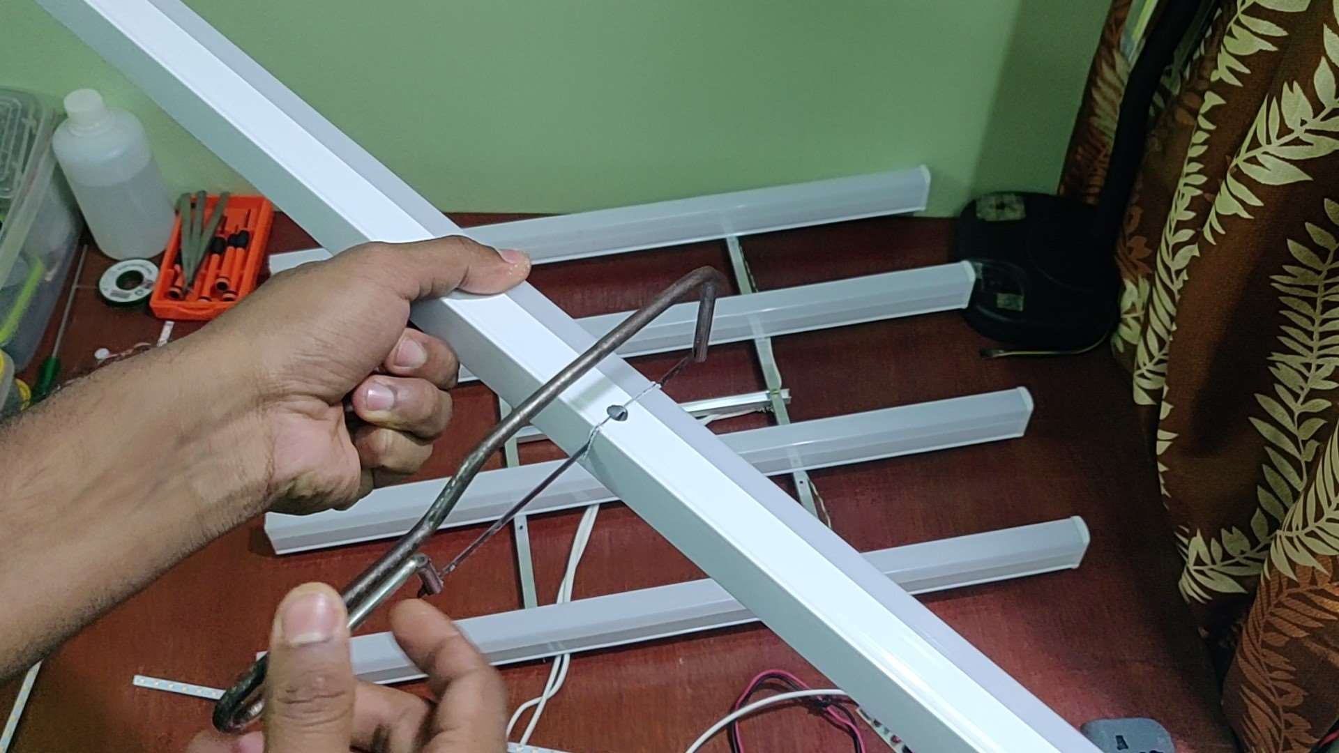 Cutting LED Tube Light Housing using a Hacksaw